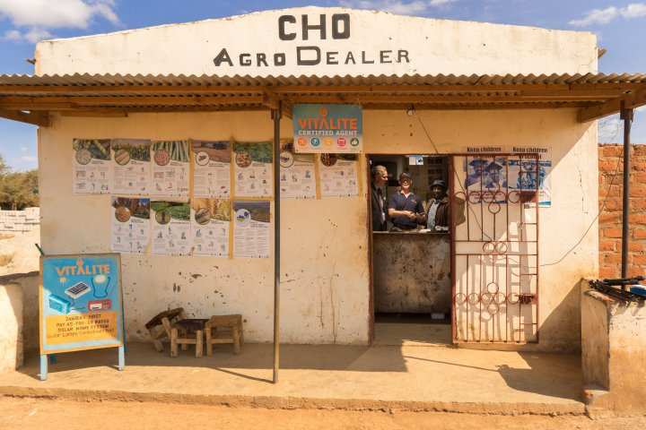 Swedish Ambassador to Zambia Henrik Cederin, VITALITE Director John Fay and long-standing VITALITE distributor Mr. Chongo at the contract signing in Mr. Chongo's shop in rural Chongwe